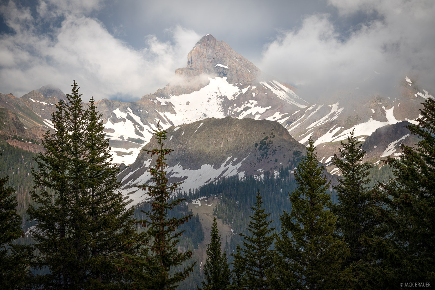 Clouds swirl off of Wetterhorn Peak after an intense thunderstorm.