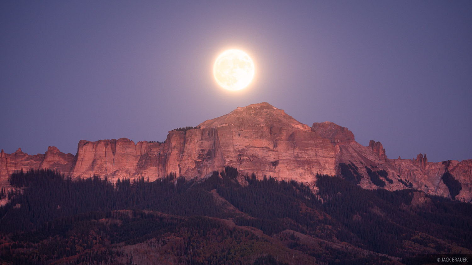 Moonrise behind Courthouse Mountain as seen from the town of Ridgway, Colorado.