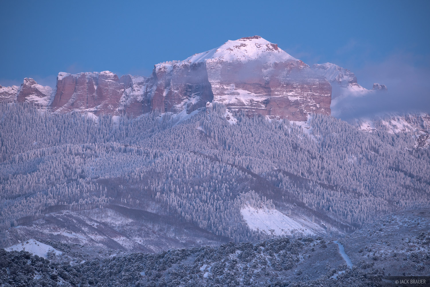 Dusk glow on snow smothered Courthouse Mountain in December.
