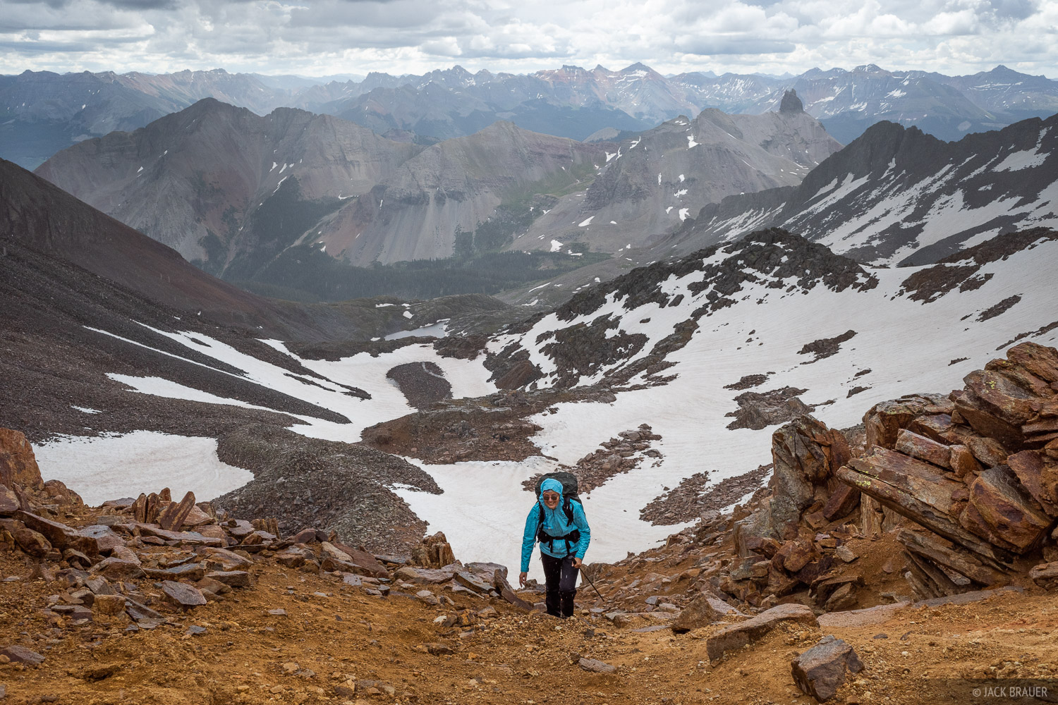 Claudia arrives at a 13,200-foot pass below Wilson Peak, just as hail starts to fall.