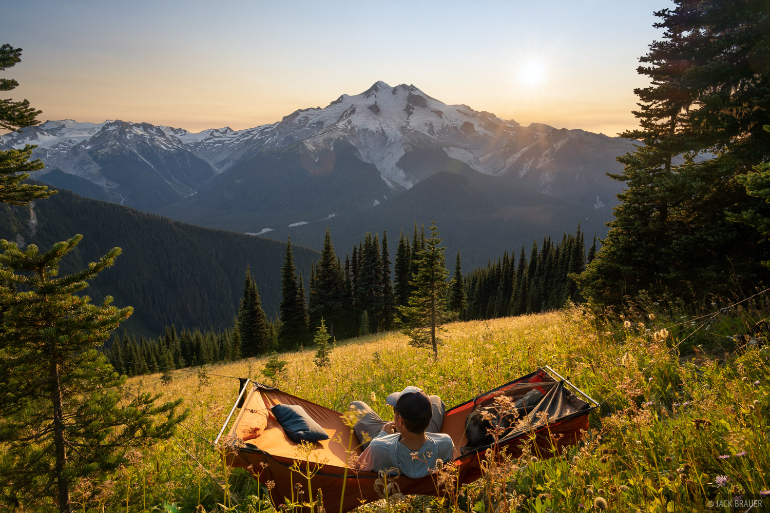 Hanging out in my hammock at a high meadow with a big view of Glacier Peak.