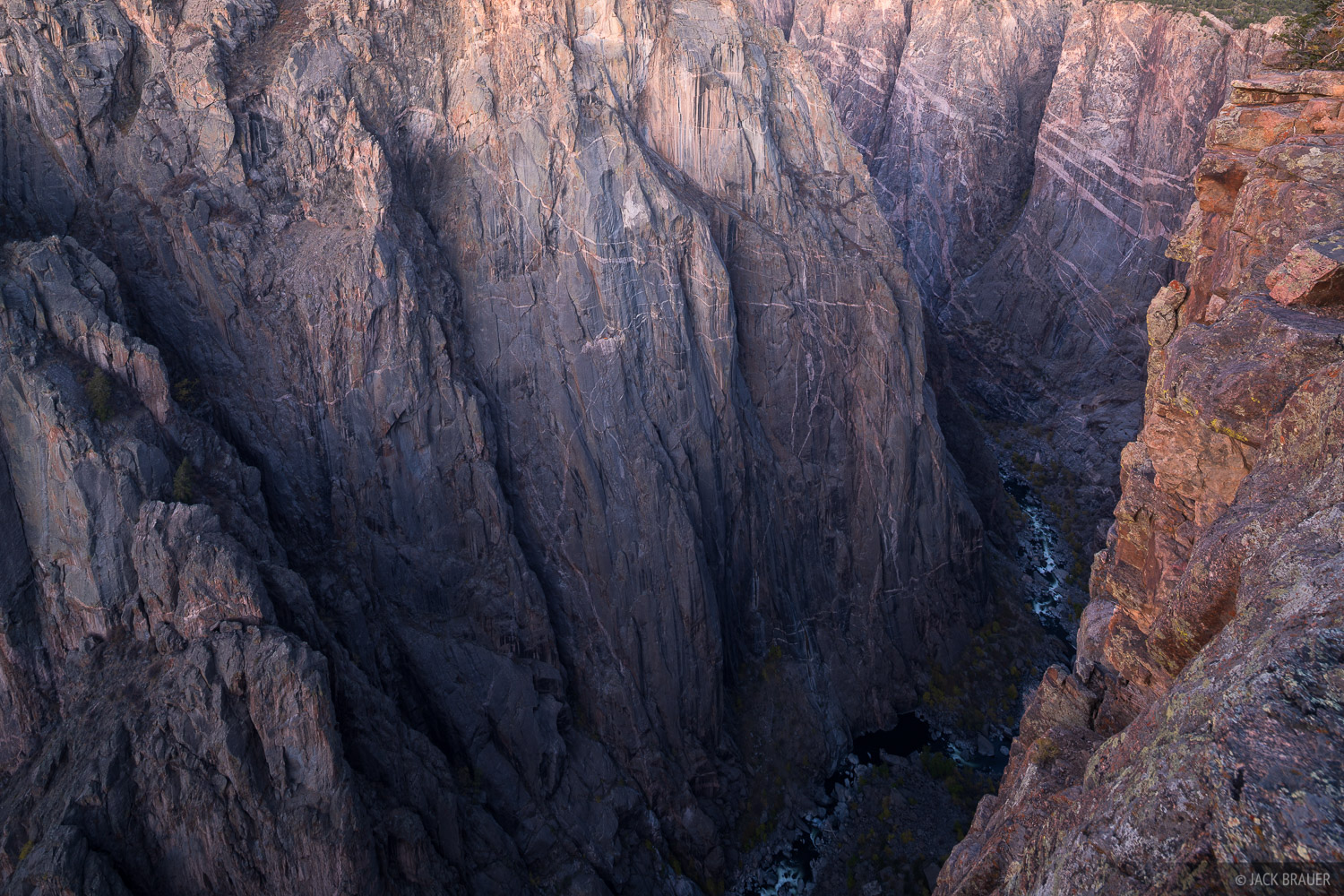 Looking 2,000 feet straight down vertical cliffs to the Gunnison River. The walls of the Black Canyon are composed of 1.8 billion...
