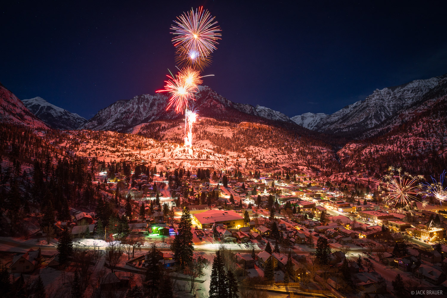 New Year's 2021 fireworks over the town of Ouray in the San Juan Mountains of Colorado. The booms echoed through the mountain...