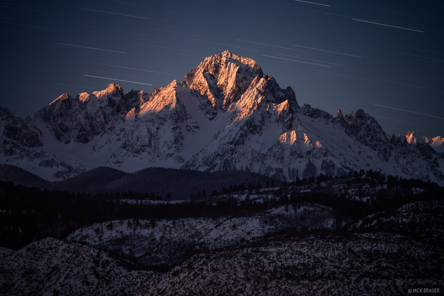 Moonrise light illuminates the summit of Mount Sneffels (14,156 ft) during a 6-minute long exposure on a cold January night.