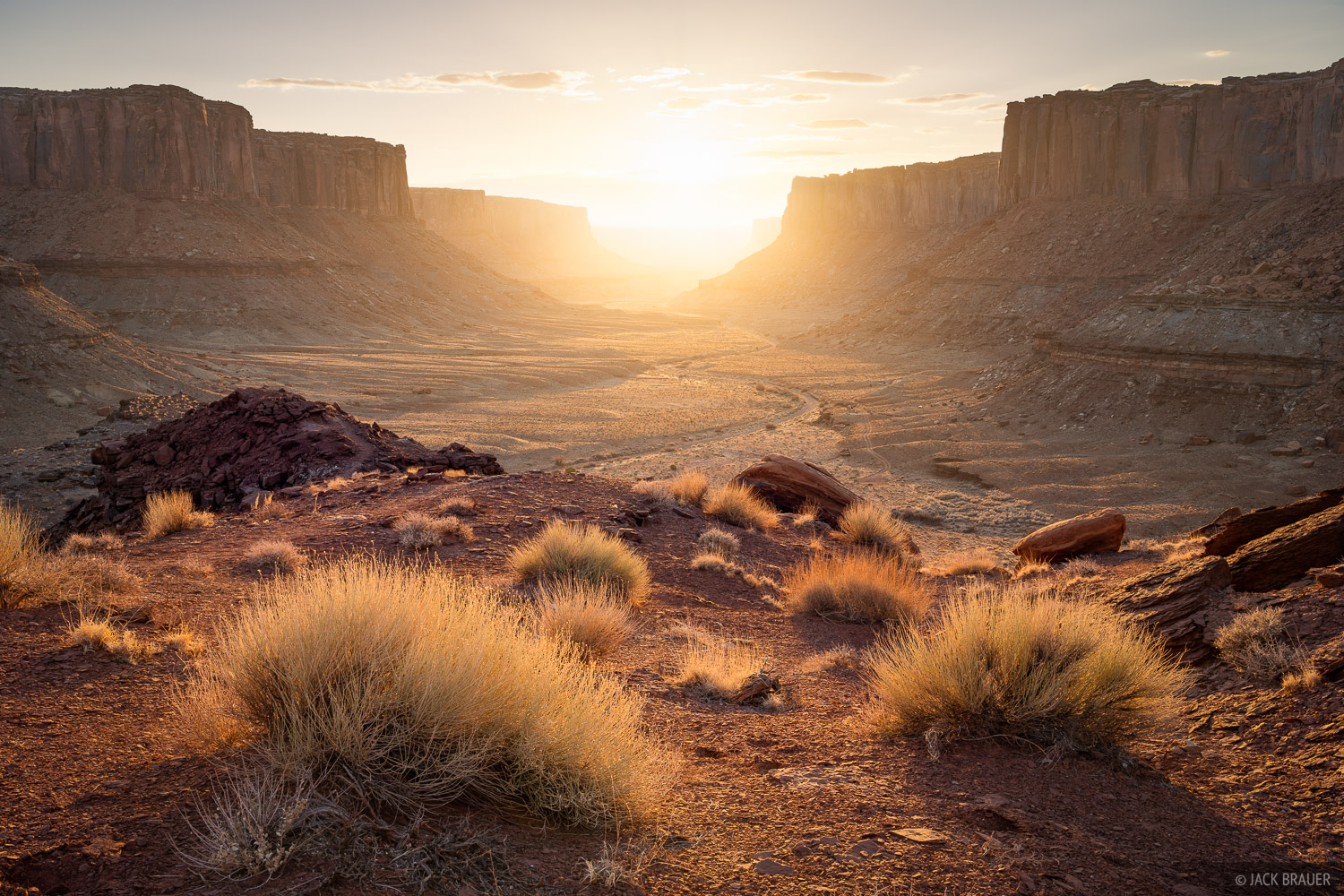 Warm sunset light shines in a remote canyon below Island in the Sky in Canyonlands National Park in Utah.
