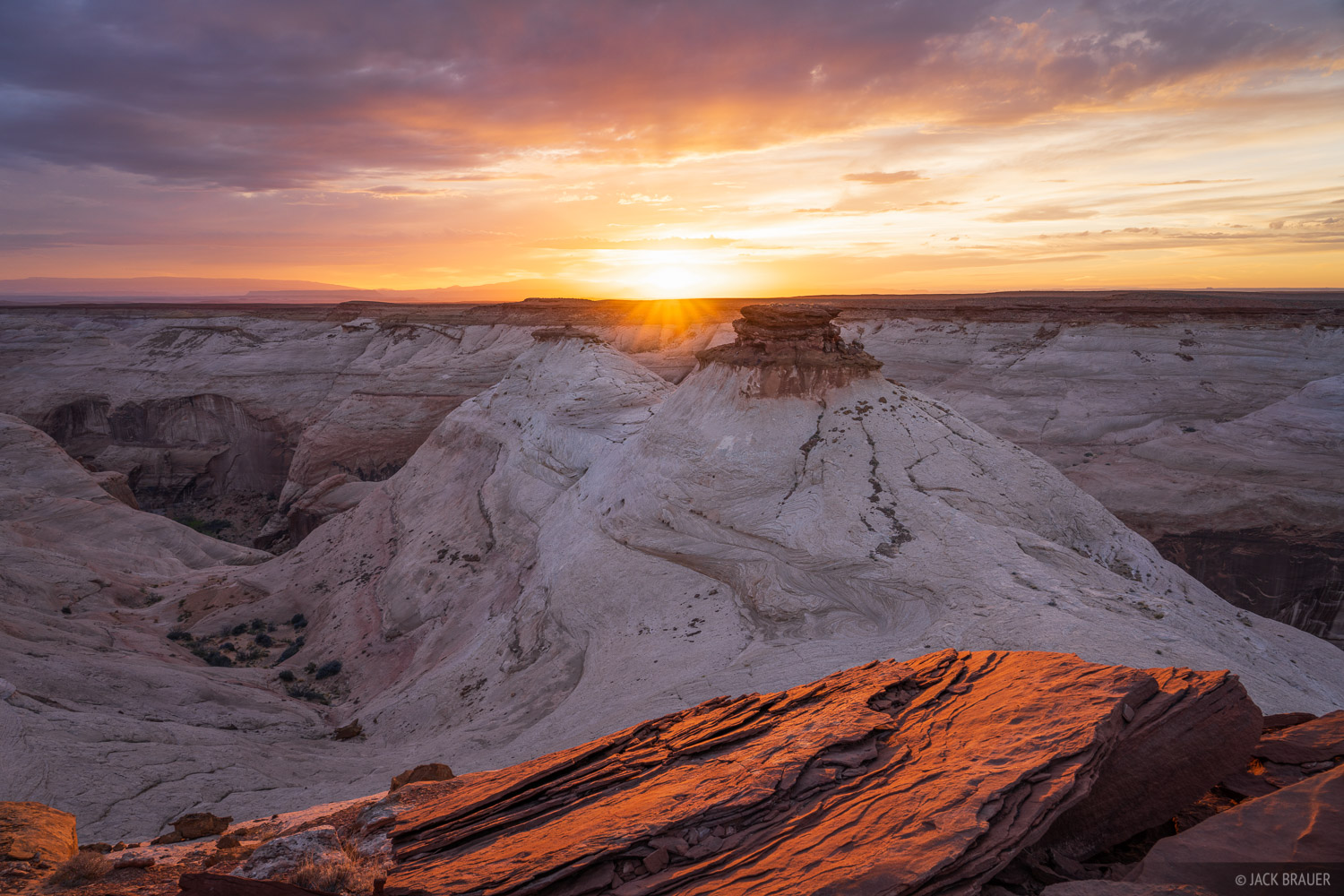 A fantastic sunset over slickrock sandstone formations in the Robbers Roost Country, a remote region of southern Utah.