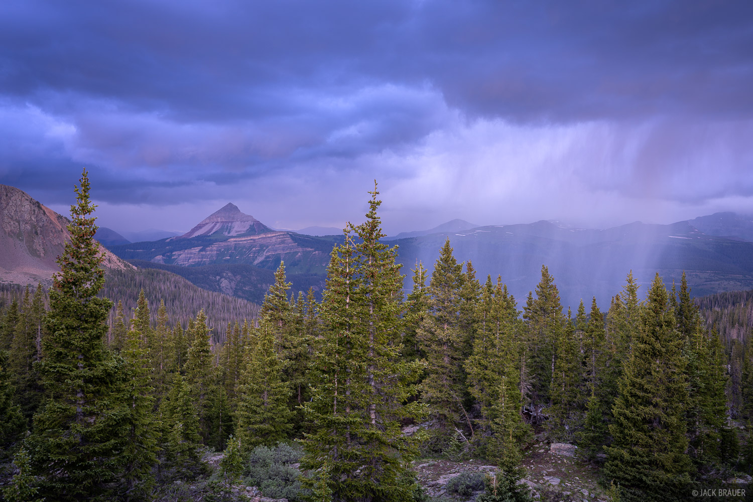 Approaching sheet of rain and ominous dark blue clouds above Engineer Mountain (12,968 ft.).