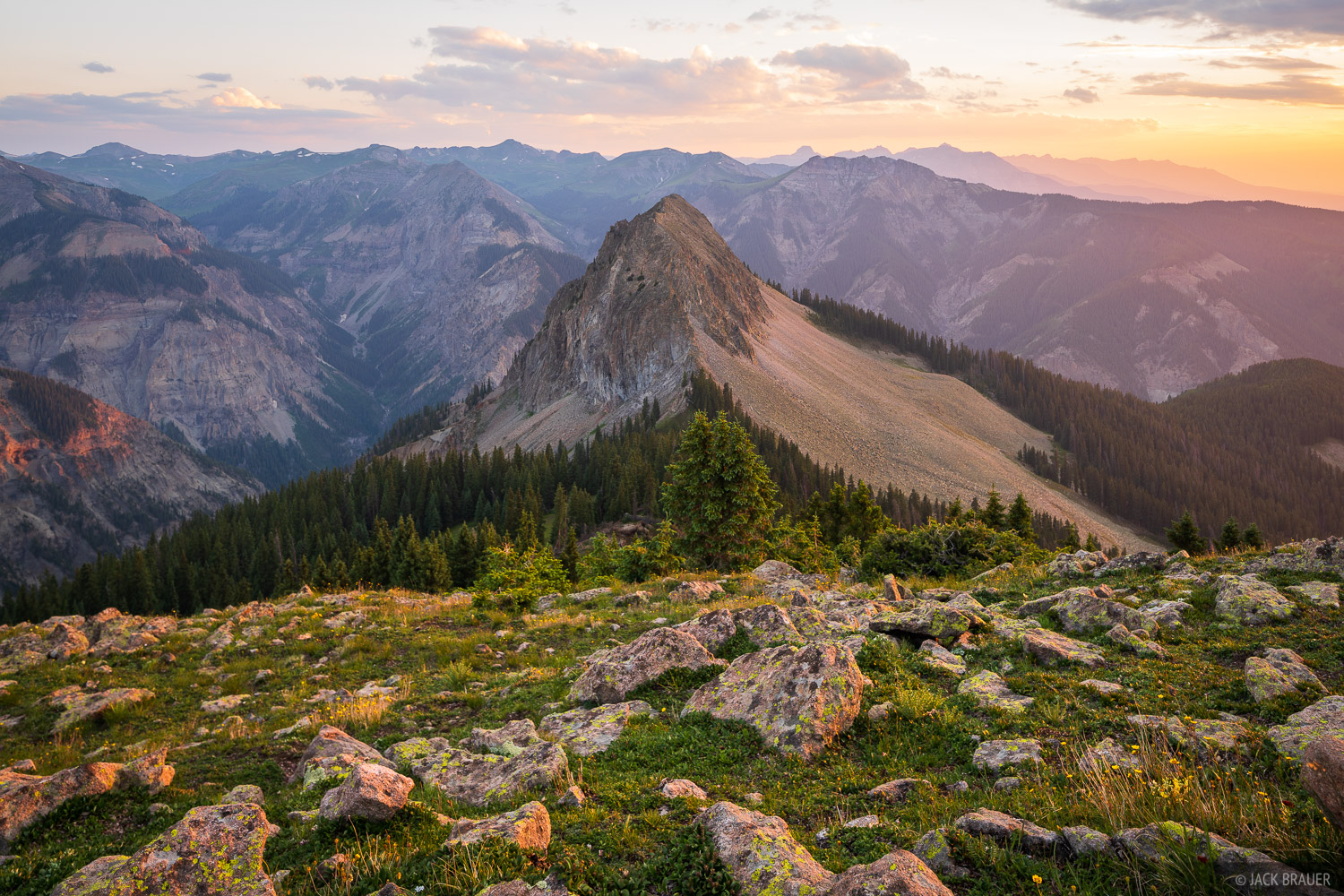 Sunset over the deep gorge of Cow Creek, in the San Juan Mountains of southwest Colorado. The Sneffels Range rises in the distance...