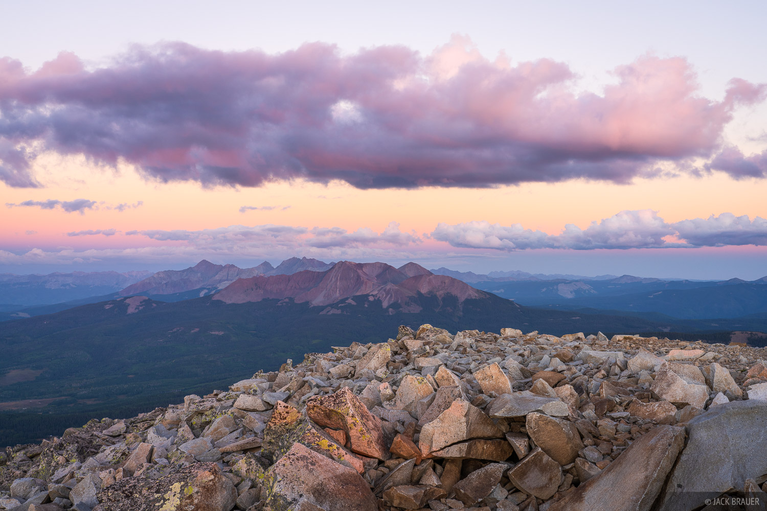 Sunset light over the San Miguel Range (and its 14ers of Wilson Peak, Mount Wilson, and El Diente) as seen from the summit of...
